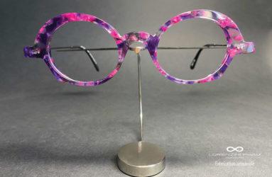 Monture femme légèrement papillon dans les tons violets et rose